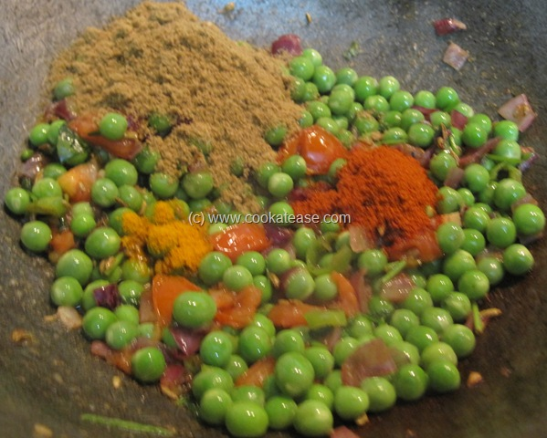 Add all dry masala powders, mix well and fry for few seconds.